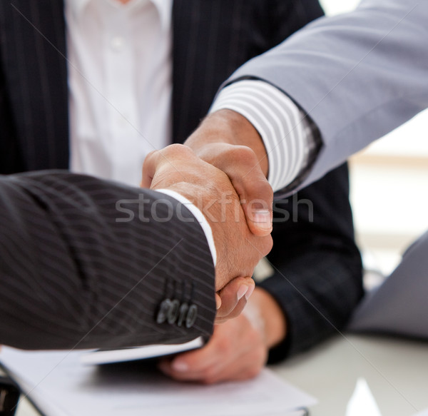 Close-up of businessmen closing a deal Stock photo © wavebreak_media