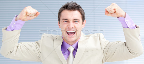 Happy businessman puniching the air  Stock photo © wavebreak_media