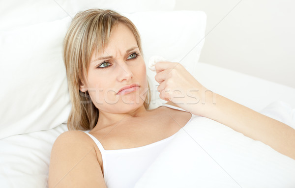 Portrait of a sick woman lying on a bed Stock photo © wavebreak_media