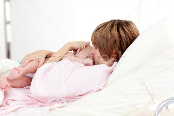 Patient kissing her baby in bed Stock photo © wavebreak_media