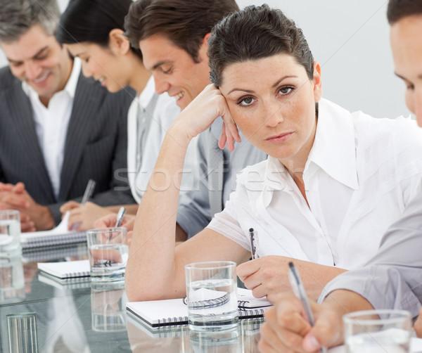 S'ennuie femme d'affaires présentation collègues réunion heureux Photo stock © wavebreak_media