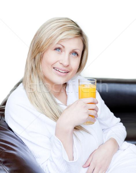 Radiant woman drinking an orange jus  Stock photo © wavebreak_media