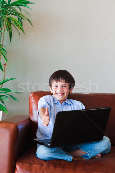 Child playing with his laptop Stock photo © wavebreak_media