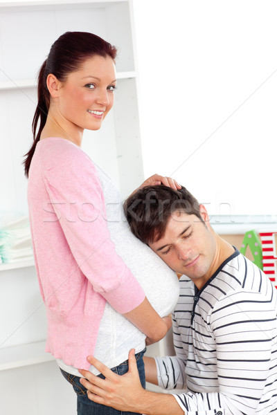 Portrait of an kind man with head on his pregnant woman's belly at home Stock photo © wavebreak_media