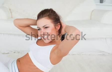 A man waking up in his bedroom Stock photo © wavebreak_media