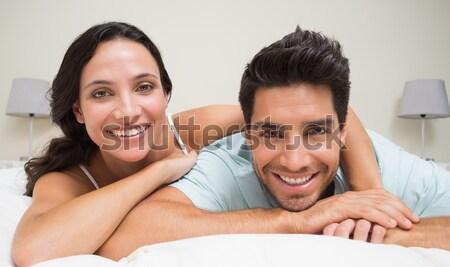 Aranyos szerelmespár néz kamera ágy nő Stock fotó © wavebreak_media