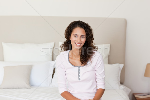 Beautiful woman lying down on her bed at home Stock photo © wavebreak_media