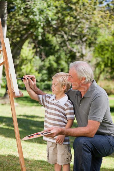 Heureux grand-père petit-fils peinture jardin famille Photo stock © wavebreak_media