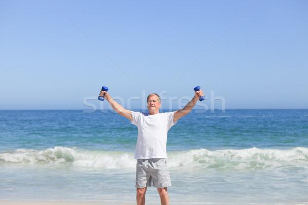 Man doing his exercises on the beach Stock photo © wavebreak_media