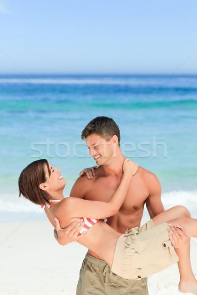 Uomo moglie spiaggia donna felice Foto d'archivio © wavebreak_media