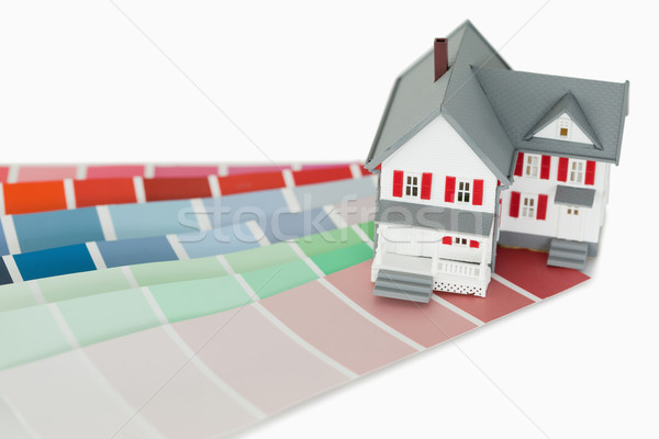 A maniature house and a color chart against a white background Stock photo © wavebreak_media