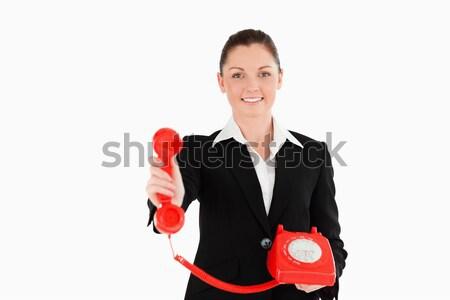 Jól kinéző nő öltöny tart piros telefon Stock fotó © wavebreak_media