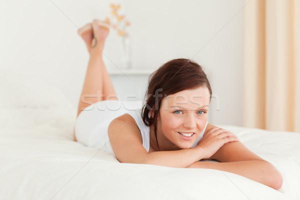 Femme lit chambre visage Photo stock © wavebreak_media