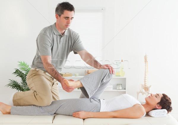 Chiropractor genç bacak el spor Stok fotoğraf © wavebreak_media