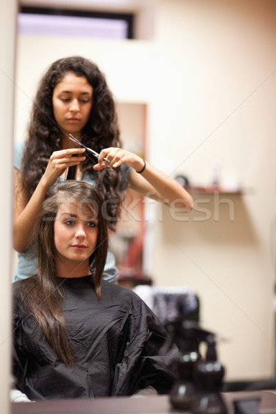 Portrait of a young woman having a haircut looking away from the camera Stock photo © wavebreak_media