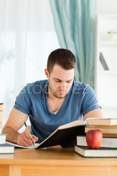 Maschio studente lavoro materiali carta scuola Foto d'archivio © wavebreak_media