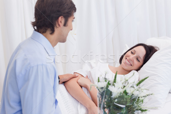 Young man visiting his girlfriend in the hospital Stock photo © wavebreak_media