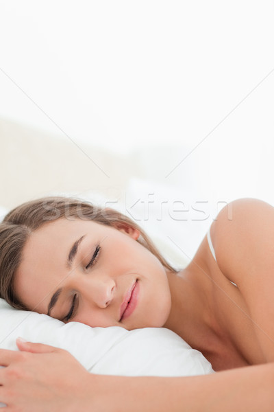 A close up shot of a woman sleeping with her head on the pillow. Stock photo © wavebreak_media