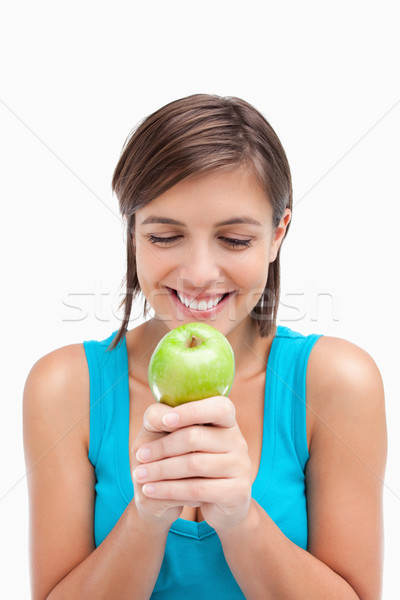 Smiling teenager crossing her hands with a green apple placed on it Stock photo © wavebreak_media