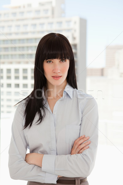 Mujer de negocios oficina los brazos cruzados negocios sonrisa feliz Foto stock © wavebreak_media