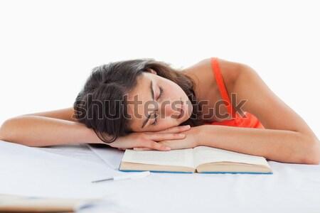 Sleeping student head on her books against white background Stock photo © wavebreak_media