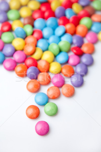 Multicolored chocolate candies against a white background Stock photo © wavebreak_media