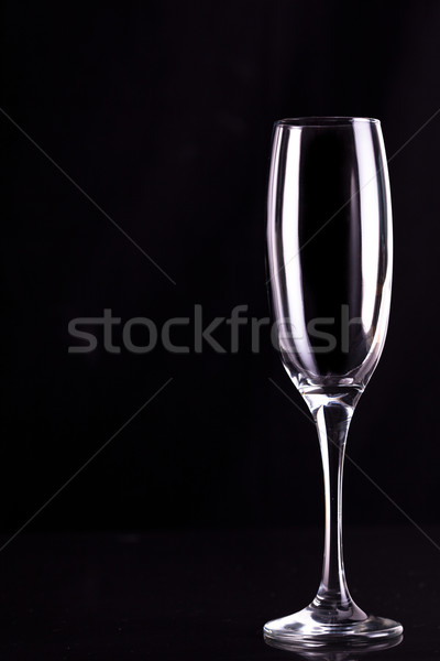 Empty champagne flute against black background Stock photo © wavebreak_media
