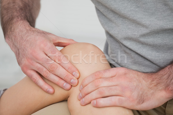 Dolente ginocchio stanza medico medici Foto d'archivio © wavebreak_media