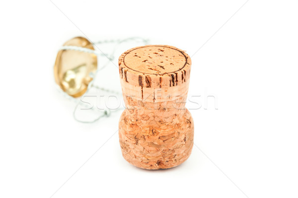 Close up of a cork and iron wire against a white background Stock photo © wavebreak_media
