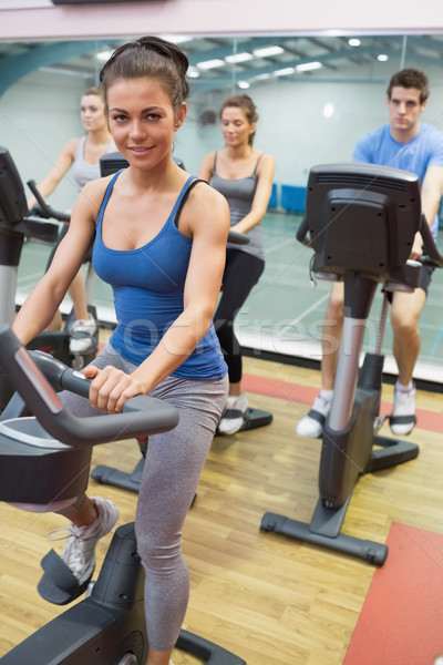 Stock photo: Woman enjoying spinning class in gym