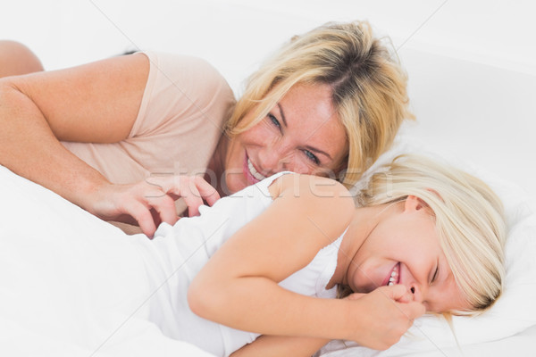 Mother tickling her daughter Stock photo © wavebreak_media