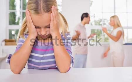 Little girl looking sad in front of fighting parents Stock photo © wavebreak_media