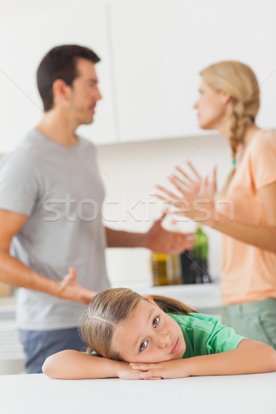 Parents arguing behind a sad girl  Stock photo © wavebreak_media