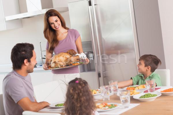 Mother carrying roast turkey for dinner Stock photo © wavebreak_media