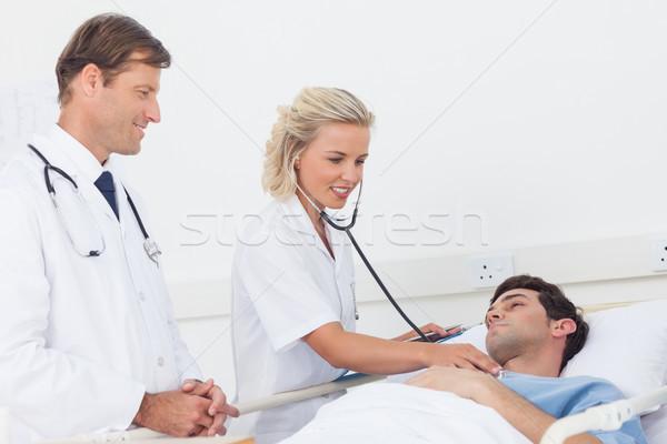 Medico battito del cuore paziente donna medici Foto d'archivio © wavebreak_media