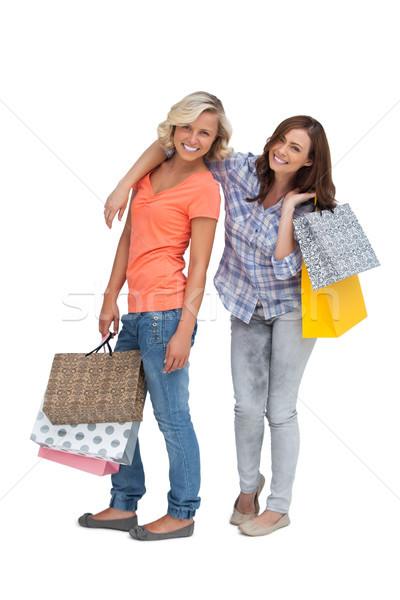 Kettő barátok tart bevásárlótáskák fehér nő Stock fotó © wavebreak_media