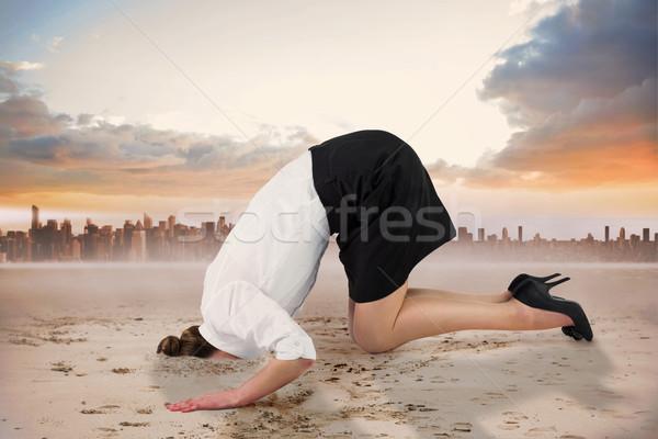Composite image of businesswoman burying her head Stock photo © wavebreak_media