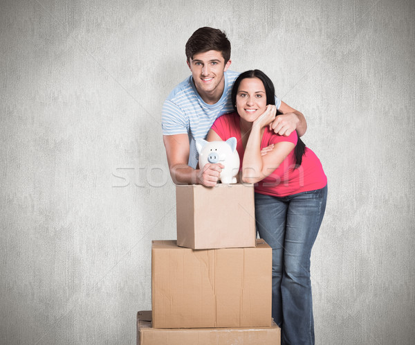 Composite image of young couple with moving boxes Stock photo © wavebreak_media