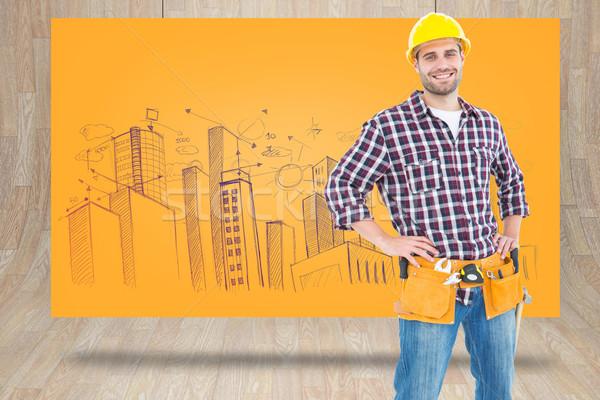 Composite image of handyman wearing tool belt while standing han Stock photo © wavebreak_media