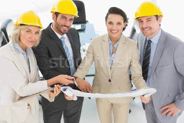 Well dressed architects with hard hats and blueprint Stock photo © wavebreak_media