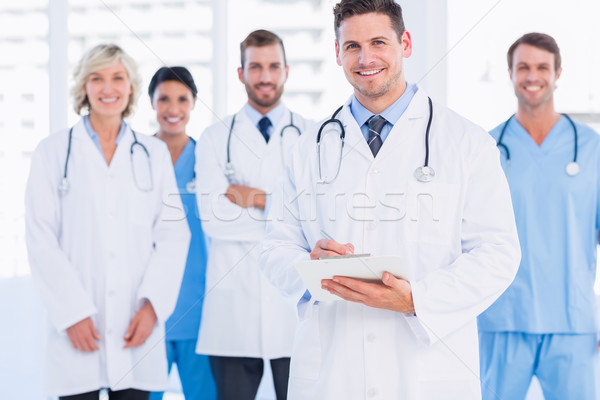 Confident happy group of doctors at medical office Stock photo © wavebreak_media