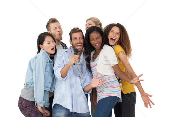Group of happy people singing into microphone Stock photo © wavebreak_media