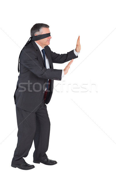 Mature businessman walking with blindfold Stock photo © wavebreak_media
