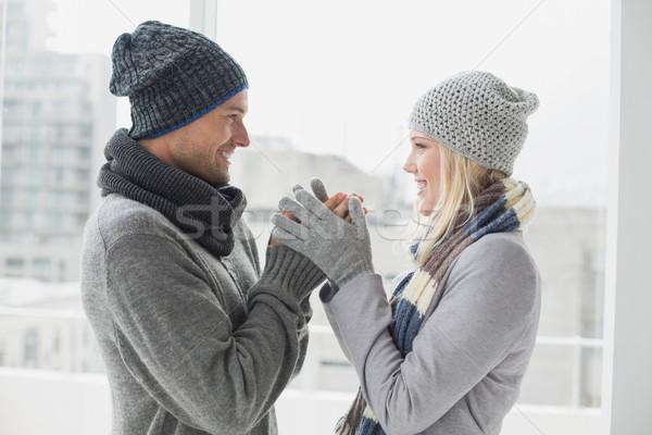 Cute Pareja ropa de abrigo sonriendo otro Foto stock © wavebreak_media
