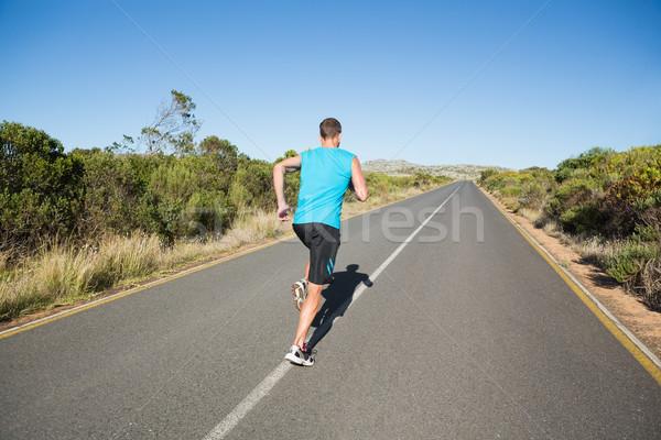 Fitt férfi jogging nyitva út napos idő Stock fotó © wavebreak_media