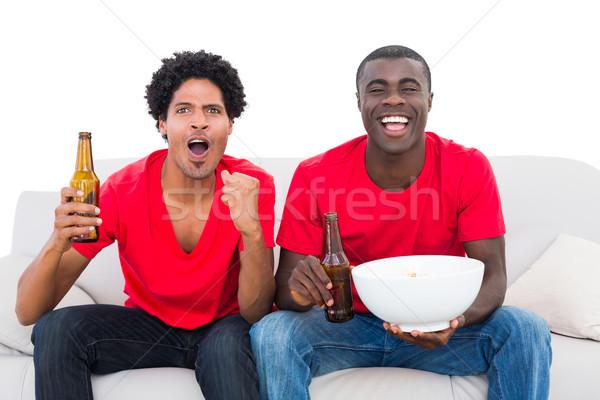 Football fans rouge canapé popcorn Photo stock © wavebreak_media