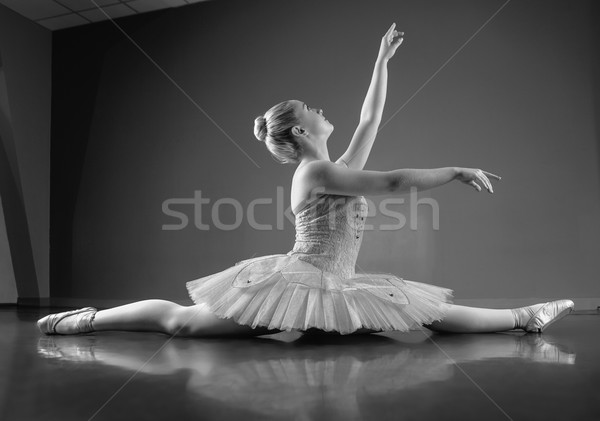 Graceful ballerina sitting with legs stretched out Stock photo © wavebreak_media