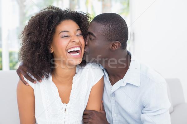 Aantrekkelijk man zoenen vriendin wang home Stockfoto © wavebreak_media