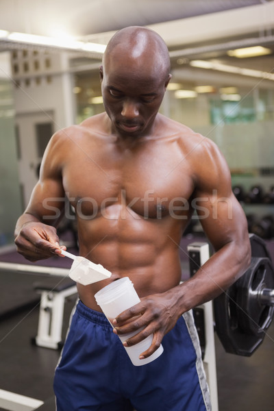 Body builder scooping up protein powder Stock photo © wavebreak_media