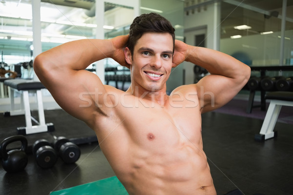 Smiling shirtless muscular man in gym Stock photo © wavebreak_media